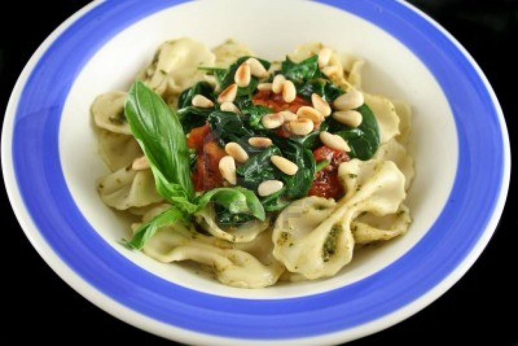 1497697-pasta-with-pesto-and-spinach-cherry-tomatoes-and-pine-nuts